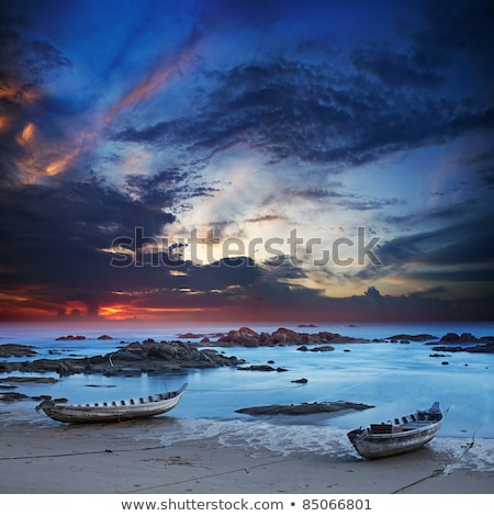 Traditional asian boats moored by the wave line. Long exposure s Stock photo © moses