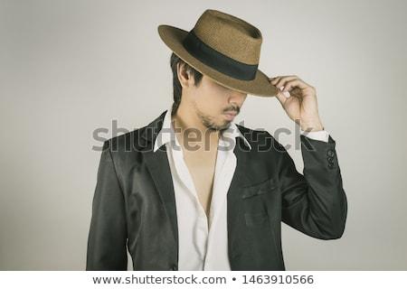 fiatal · jóképű · férfi · pózol · stúdió · kalap · áll - stock fotó © Elmiko