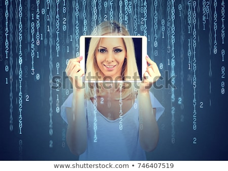 a beautiful young business woman holding her tablet personal com stock photo © hasloo