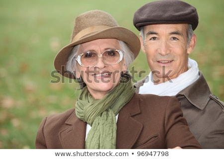Elderly couple out for a stroll on a Sunday afternoon Stock photo © photography33