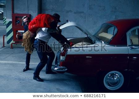 Jonge vrouw gijzelaar vrouw zwarte stress Stockfoto © marylooo