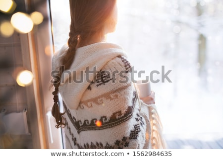 Beautiful winter woman looking Stock photo © Fernando_Cortes