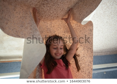 Woman hanging wallpaper motif Stock photo © photography33