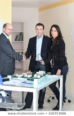 Architect stood with young couple concluding deal Stock photo © photography33