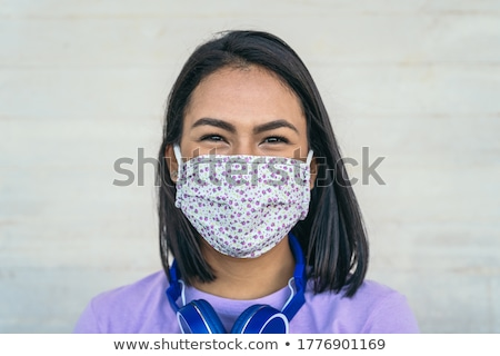 Smiling woman in a facemask Stock photo © stryjek