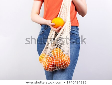 Woman holding fruit Stock photo © photography33