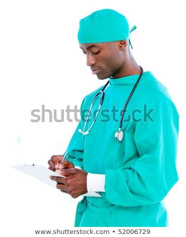 Karizmatikus orvos készít jegyzetek vágólap kórház Stock fotó © wavebreak_media