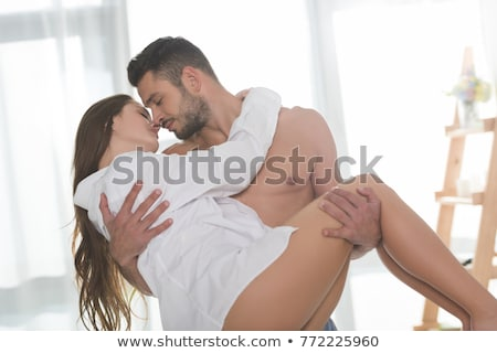 Boyfriend kissing his girlfriend in bed stock photo © wavebreak_media