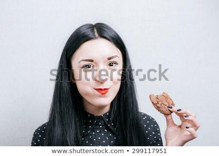 Joyful pretty girl eating chocolate biscuit Stock photo © acidgrey