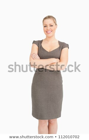 Donna piedi braccia incrociate pancia bianco suit Foto d'archivio © wavebreak_media