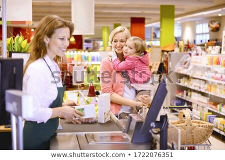 Woman holding an Apron Stock photo © piedmontphoto