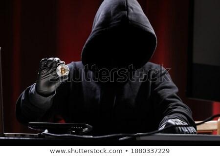 Thief steeling a computer Stock photo © AndreyPopov