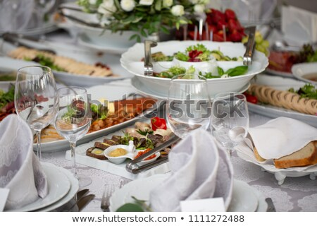 covered table with plate appetizers Stock photo © Farina6000