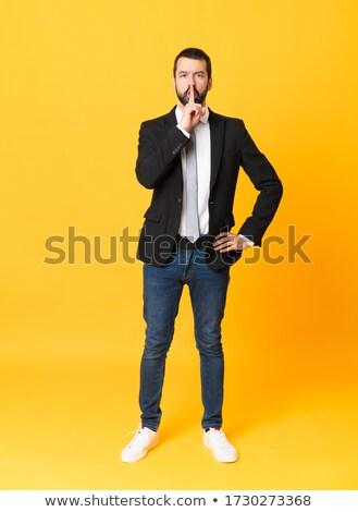 hispanic businessman putting fingers on lips, shh Stock photo © pxhidalgo