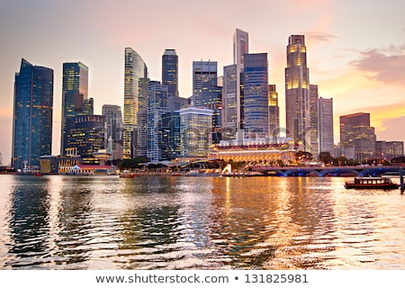 Singapore stadsgezicht zonsondergang hemel kantoor gebouw Stockfoto © leungchopan