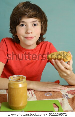 boy with peanut stock photo © lenm