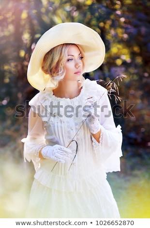 retrato · mujer · sombrero · flores · cielo · cara - foto stock © konradbak
