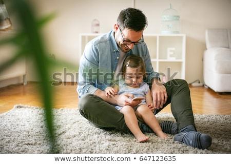 отец мобильных ребенка сидят зеленая трава мобильного телефона Сток-фото © d13