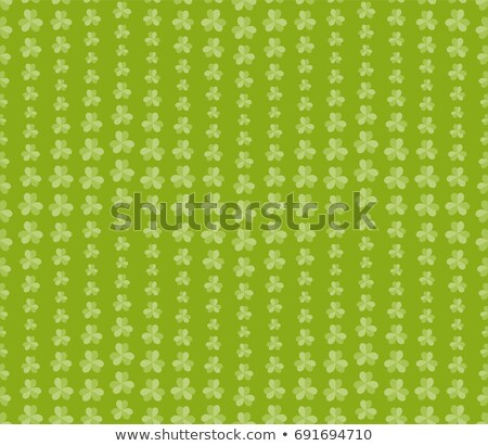 saint patricks day seamless background with shamrocks and gold coins stock photo © loopall