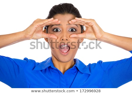 curious surprised shocked woman peeking through fingers like binoculars stock photo © ichiosea