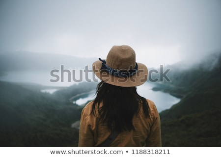 young woman in hat with binoculars stock photo © master1305