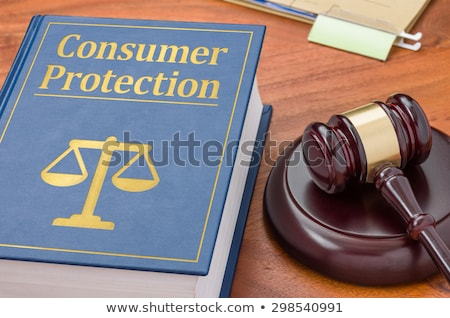 a law book with a gavel   consumer protection stock photo © zerbor