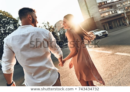 young couple walking in the city stock photo © smuki