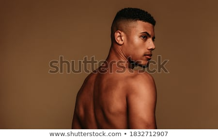 Side view portrait of afro american man Stock photo © deandrobot