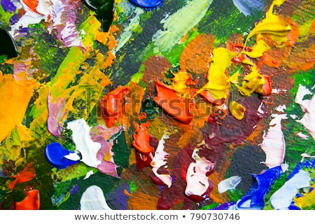 Artist's hand close-up on the background of palette  Stock photo © master1305