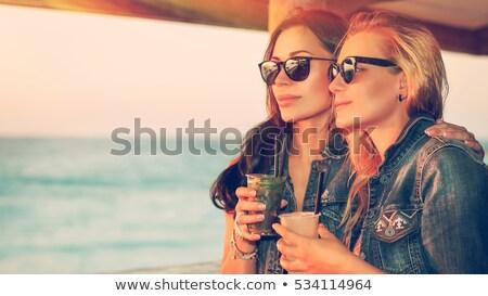 twee · mooie · jonge · vriendinnen · bikini · strand - stockfoto © kzenon