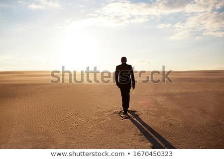 Egyedül sivatag emberek égbolt utazás homok Stock fotó © t3mujin