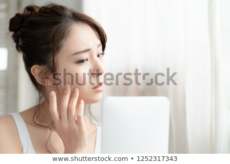 Woman with skin problem Stock photo © bluering