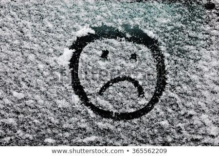 Sad smiley emoticon face drawn on snow covered glass Stock photo © stevanovicigor