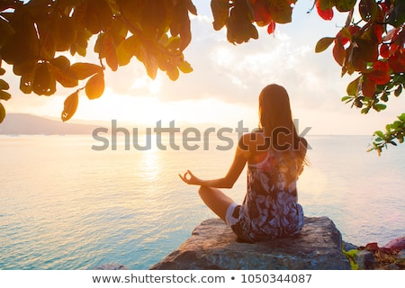 woman meditate under the colorful tree stock photo © tefi