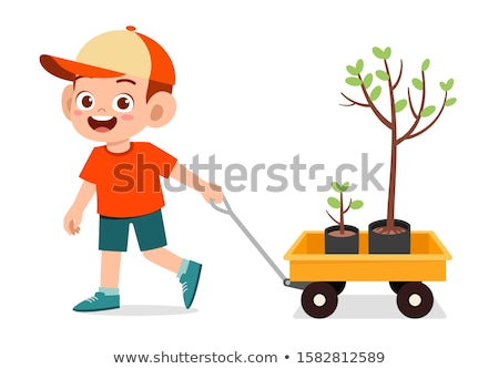 Girl pulling wagon with green tree Stock photo © bluering