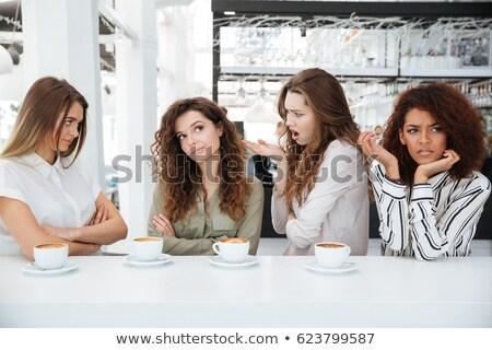 четыре молодые недовольный друзей сидят кафе Сток-фото © deandrobot