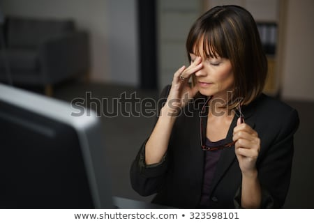 Woman Rubbing Her Eyes Stock photo © AndreyPopov