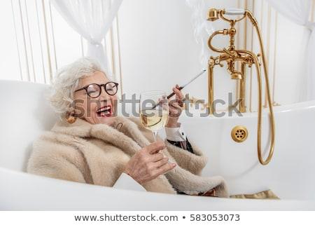 Nő cigaretta dohányzás fürdőkád visel káprázatos Stock fotó © deandrobot