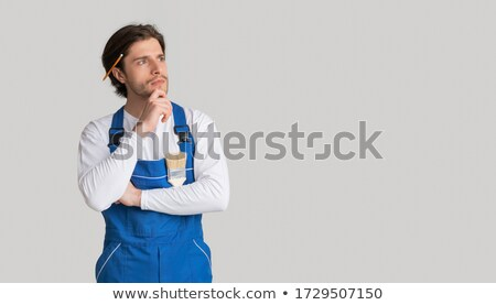 portrait of a pensive young male builder working stock photo © deandrobot