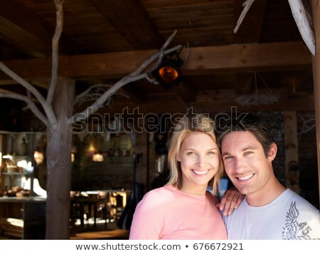 man and woman smiling in lodge bar Stock photo © IS2
