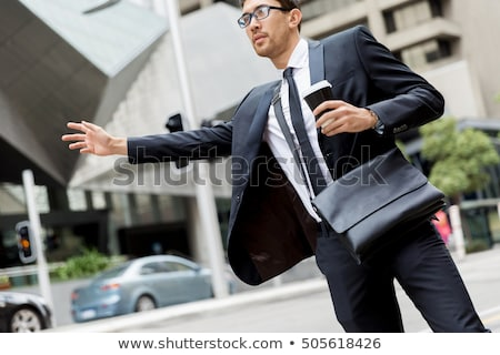 Businessman hailing taxi on city street Stock photo © IS2