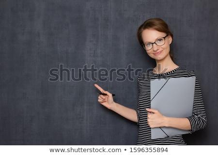 Empresária em pé documentos mão corporativo Foto stock © studioworkstock
