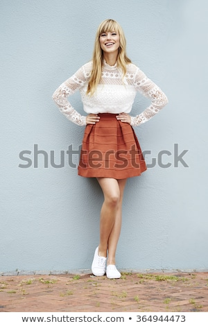 Young blonde woman against yellow background Stock photo © IS2