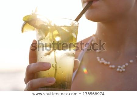 Ragazza spiaggia bevanda fredda cocktail donna corpo Foto d'archivio © alphaspirit