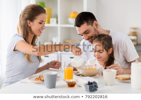 Family eating breakfast in kitchen Stock photo © IS2