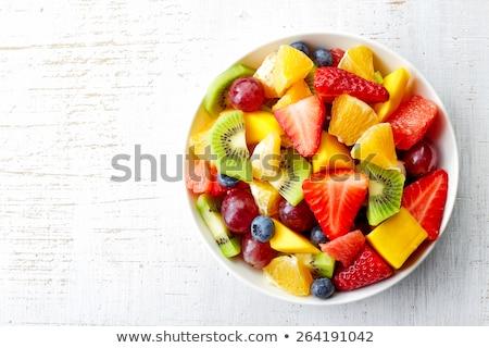 Gyümölcssaláta háttér gyümölcsök eper fehér friss Stock fotó © M-studio