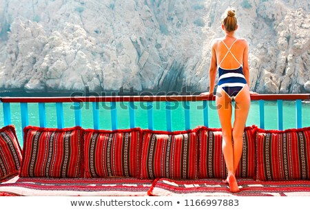 Young woman wearing summer swimsuit on an old fashioned ship Stock photo © dashapetrenko