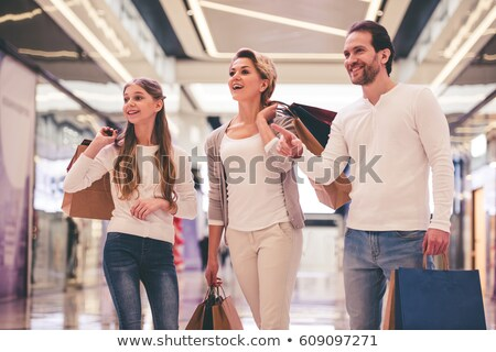 father and daughter shopping clothes in retail store stock photo © kzenon
