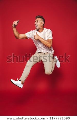 Tam uzunlukta fotoğraf mutlu adam çizgili tshirt Stok fotoğraf © deandrobot