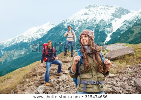 couple with backpacks over alps mountains Stock photo © dolgachov